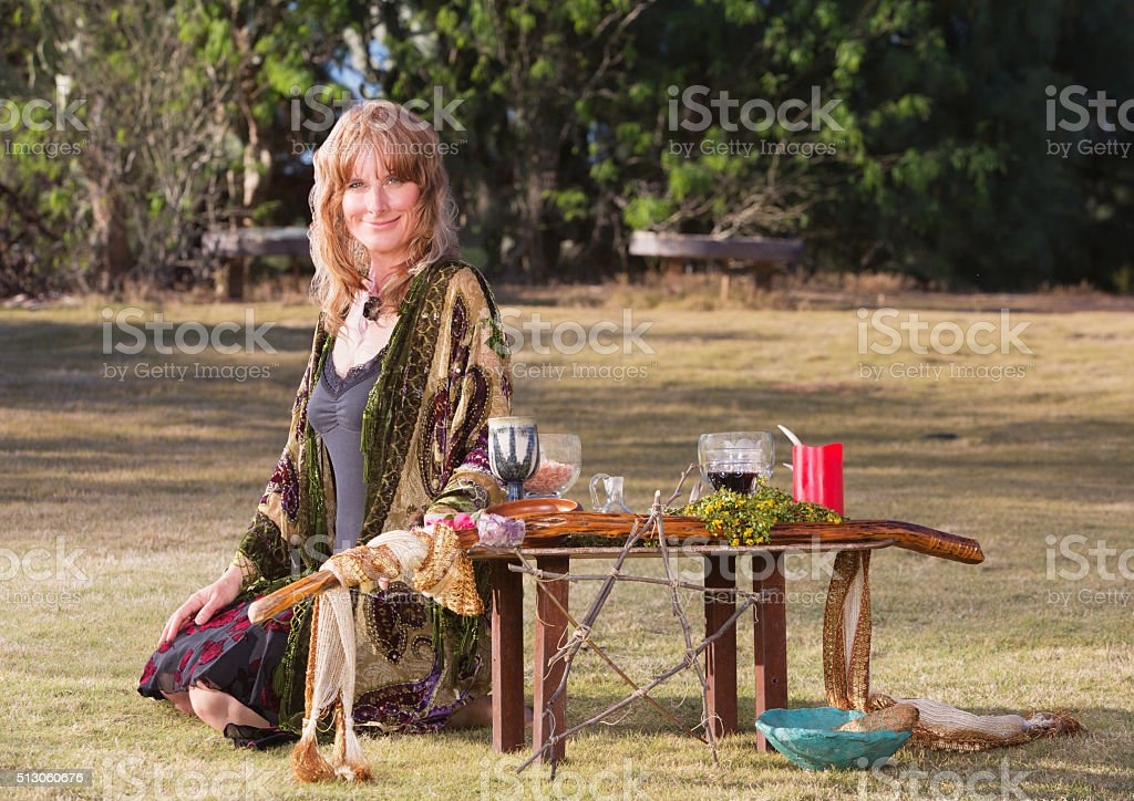 Beautiful Witch with Altar stock photo