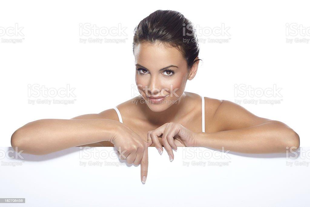 Beautiful woman above white blank billboard royalty-free stock photo