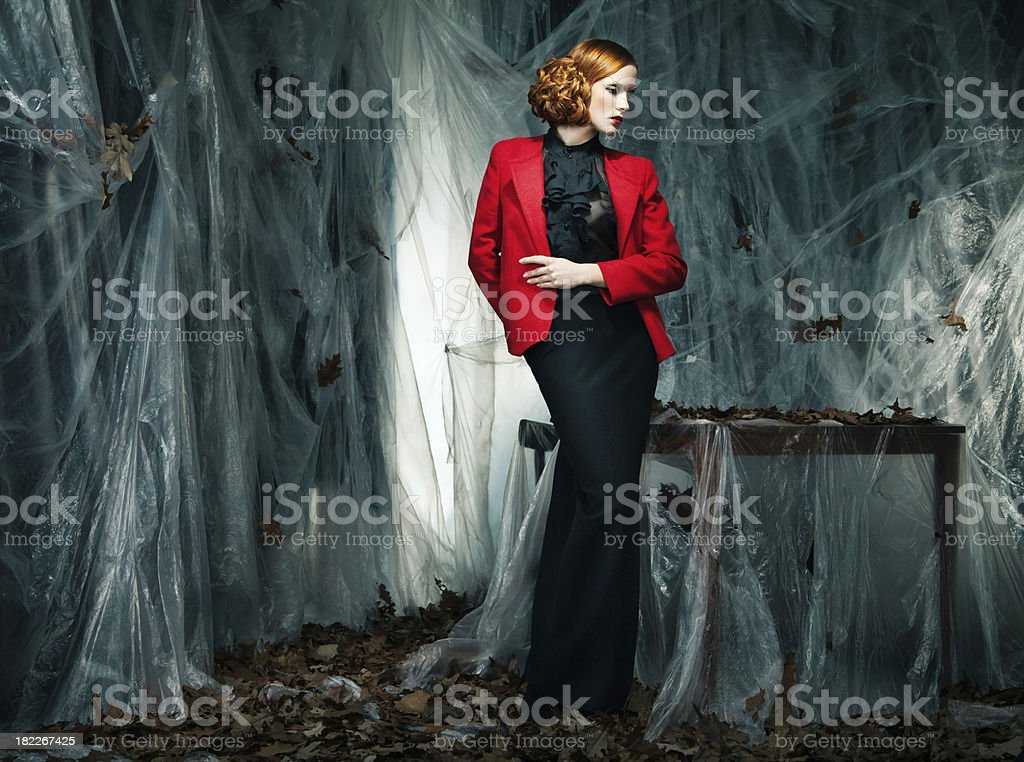 Beautiful woman against autumn decoration. Fashion royalty-free stock photo
