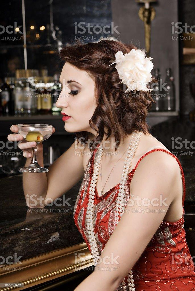 Beautiful Woman Alone At A Bar stock photo