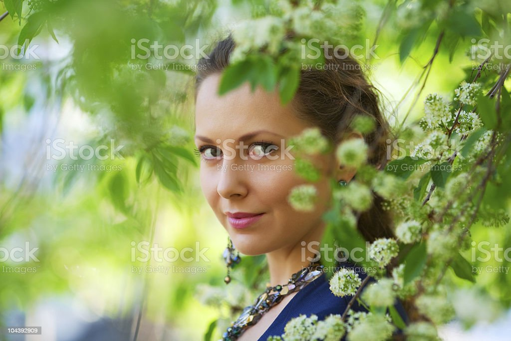 Beautiful woman among blossoming trees royalty-free stock photo