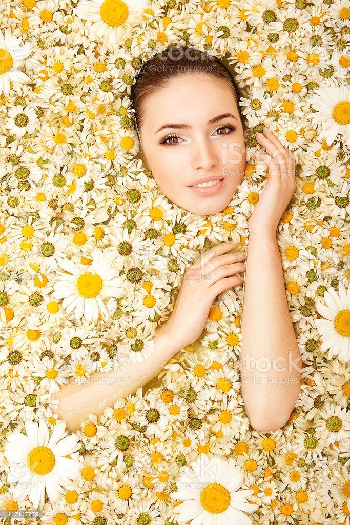 Beautiful woman and chamomiles stock photo