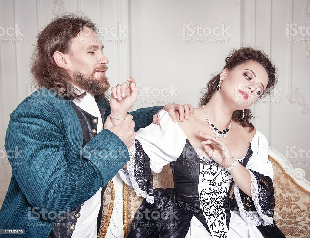 Beautiful woman and man in medieval clothes stock photo