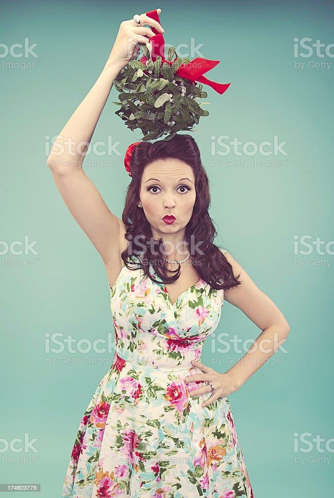 Beautiful Woman and Mistletoe stock photo