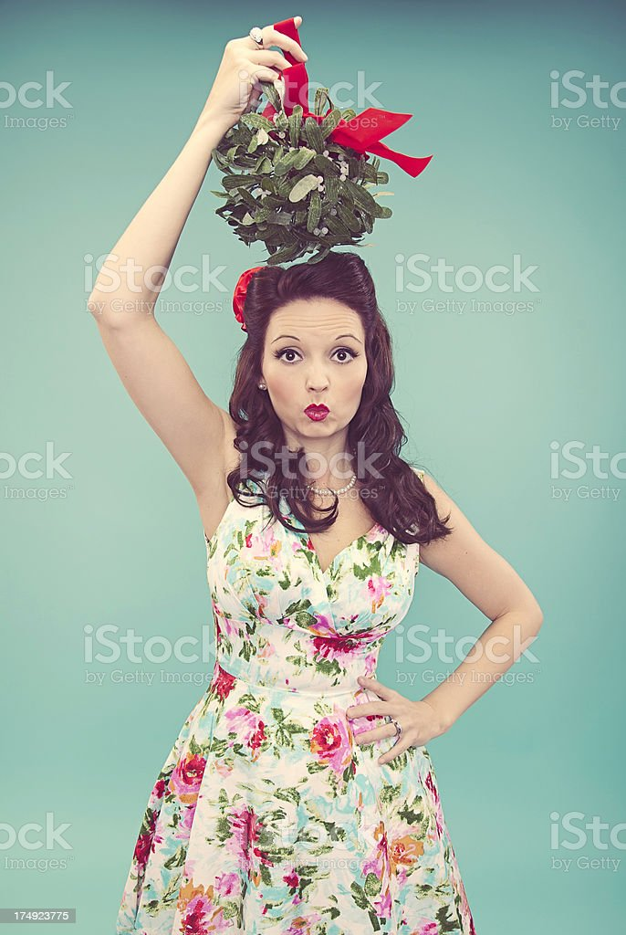 Beautiful Woman and Mistletoe stock photo