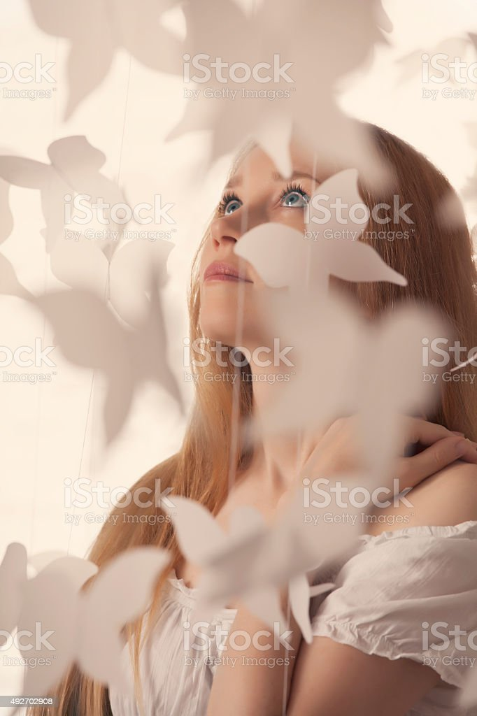 Beautiful woman and paper butterflies stock photo