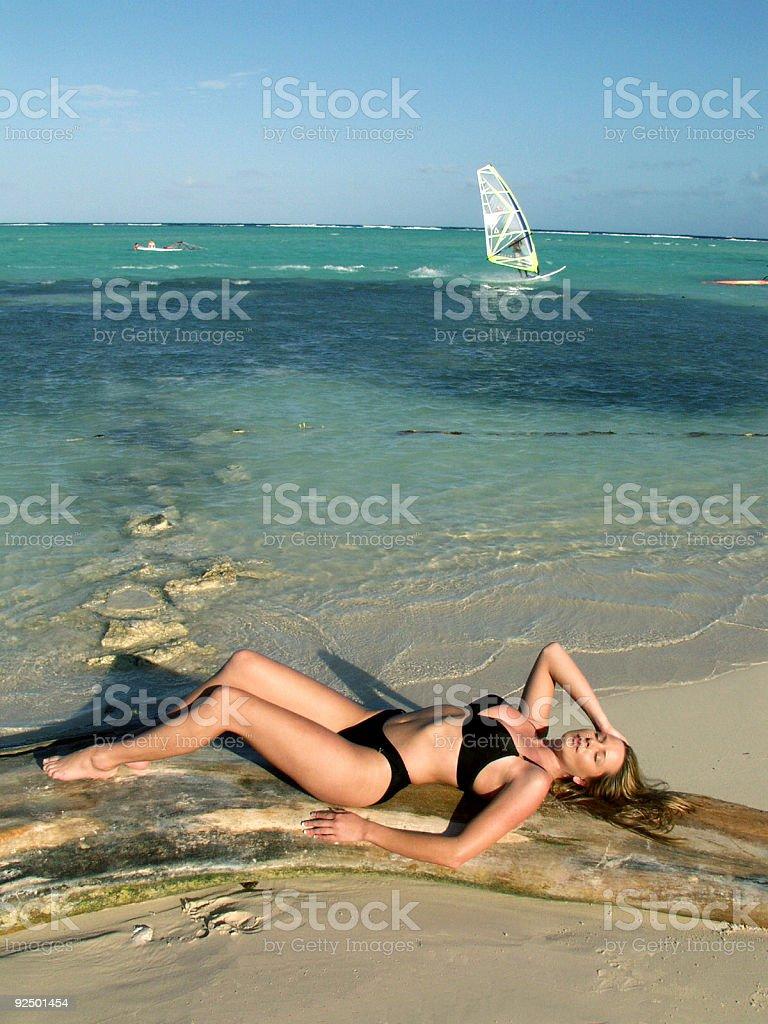 Beautiful Woman and Windsurfer royalty-free stock photo