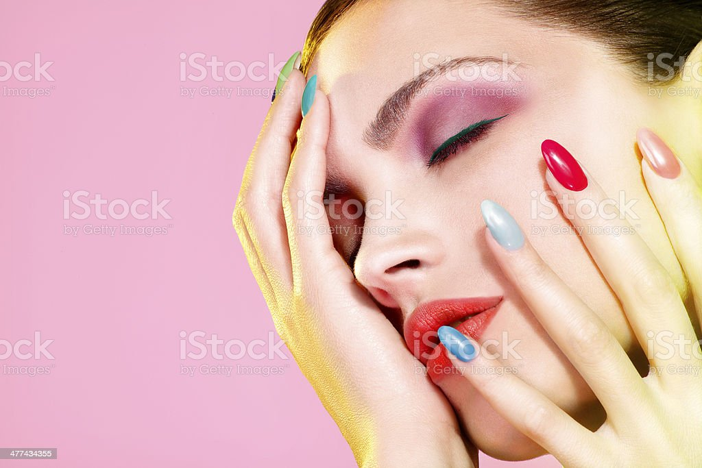 Beautiful woman applying cream treatment on her perfect face stock photo