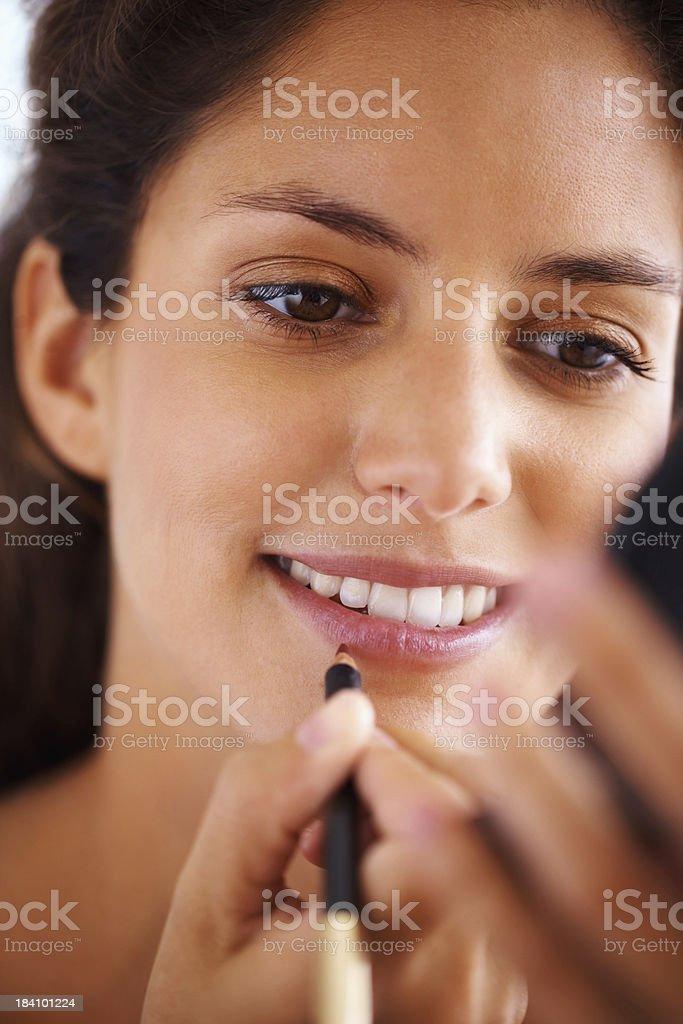 Beautiful woman applying lip liner royalty-free stock photo