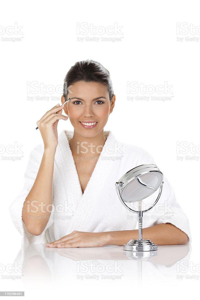 Beautiful Woman Applying Make-Up royalty-free stock photo