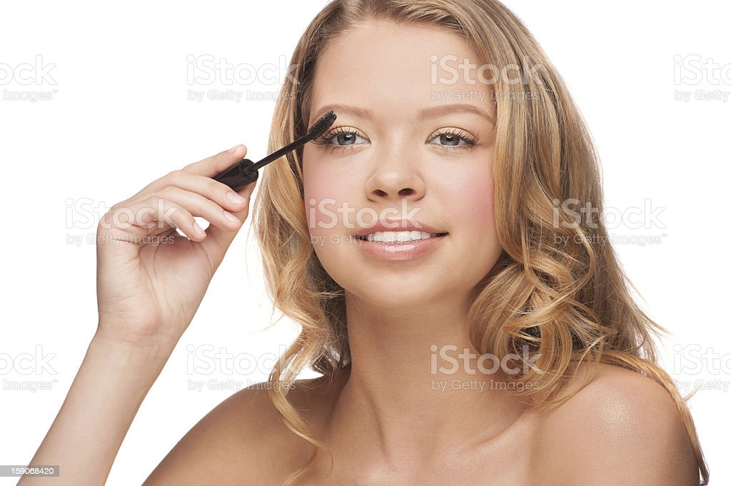 Beautiful woman applying mascara royalty-free stock photo