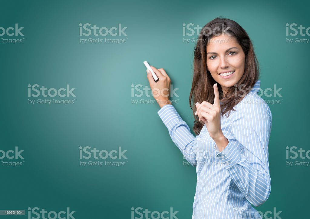 Beautiful Woman asking for Attention writing on Blackboard stock photo