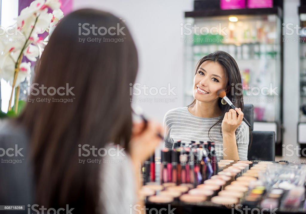 Beautiful woman at a makeup store stock photo