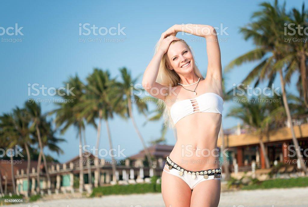Beautiful woman at a Palm Tree Beach at Sunrise stock photo