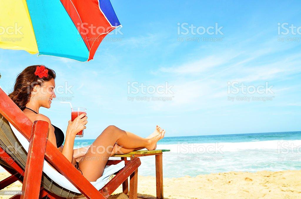 Beautiful woman at  beach in summer near ocean coastline stock photo