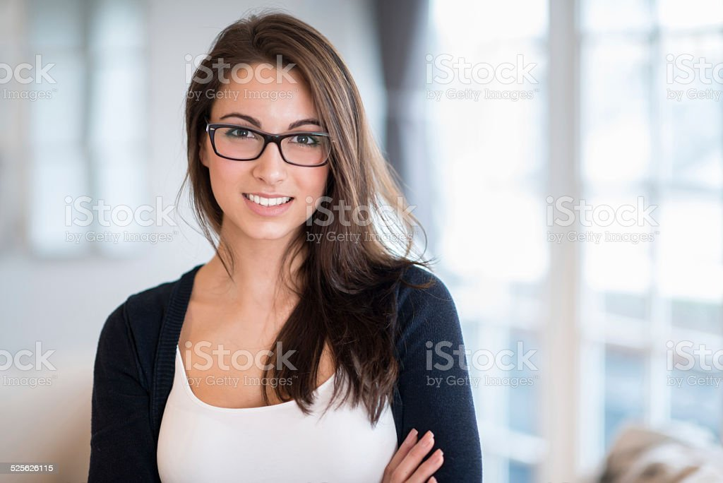 Beautiful woman at home stock photo