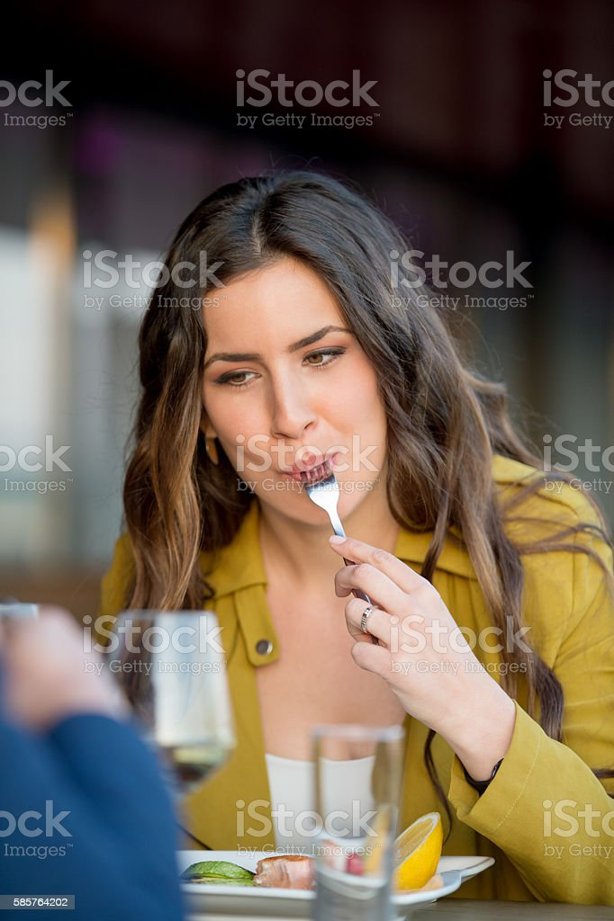 Beautiful woman at outdoor restaurant stock photo