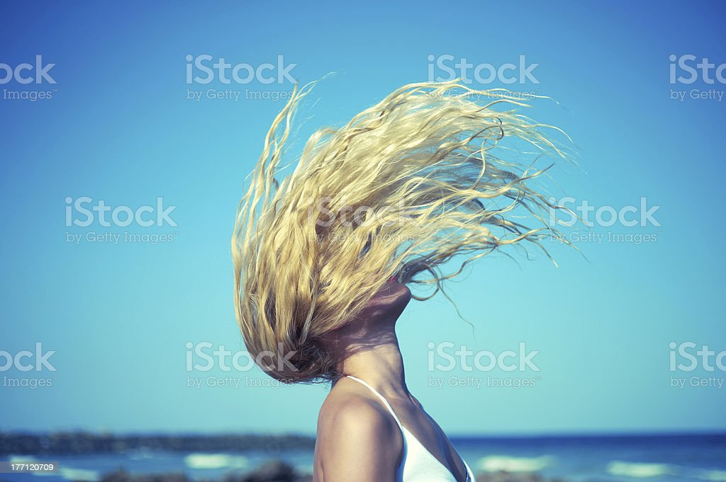 Beautiful woman at sea stock photo