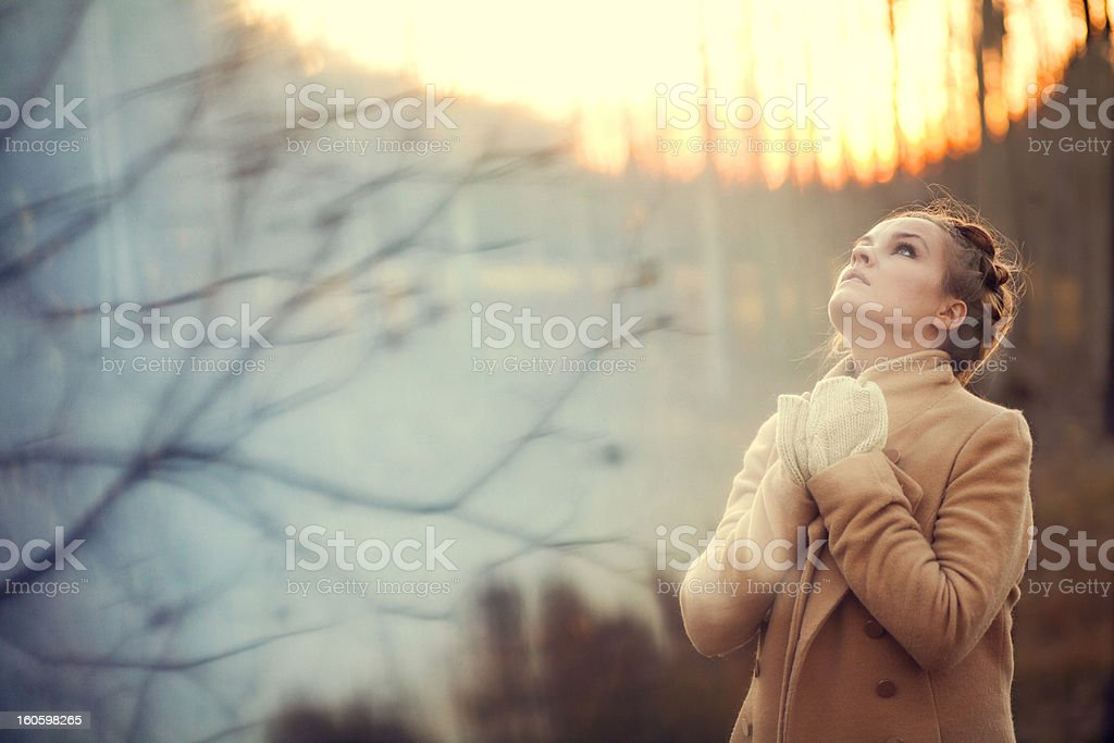 beautiful woman at sunset stock photo