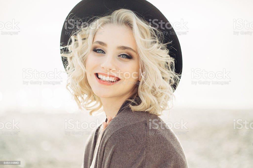 Beautiful woman at the beach stock photo