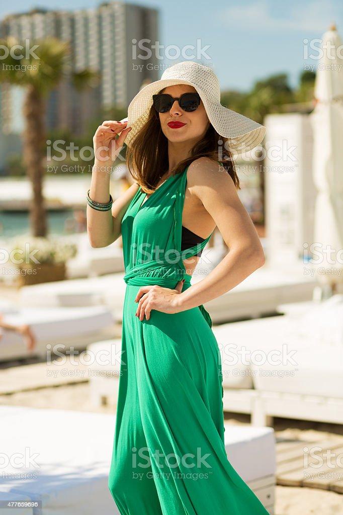 Beautiful woman at the beach resort stock photo