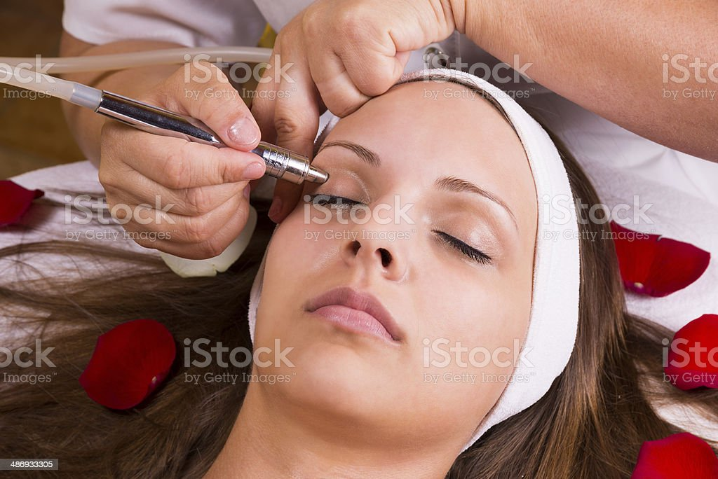 Beautiful woman at the beautician. stock photo