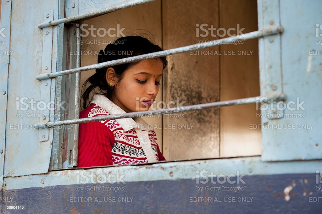 Beautiful woman at the window of train stock photo