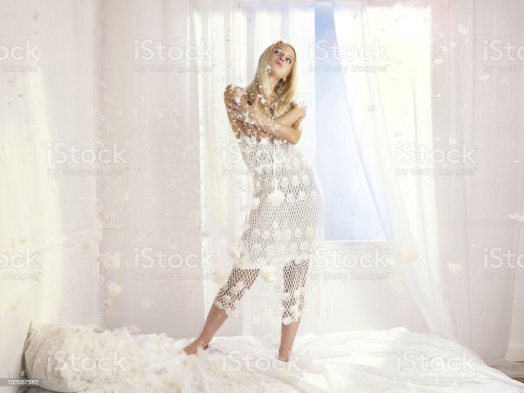 Beautiful woman at the window royalty-free stock photo
