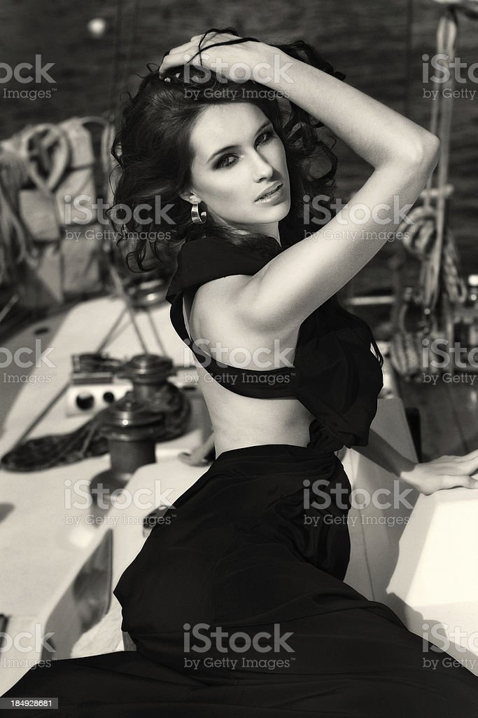 Beautiful woman at the yacht royalty-free stock photo