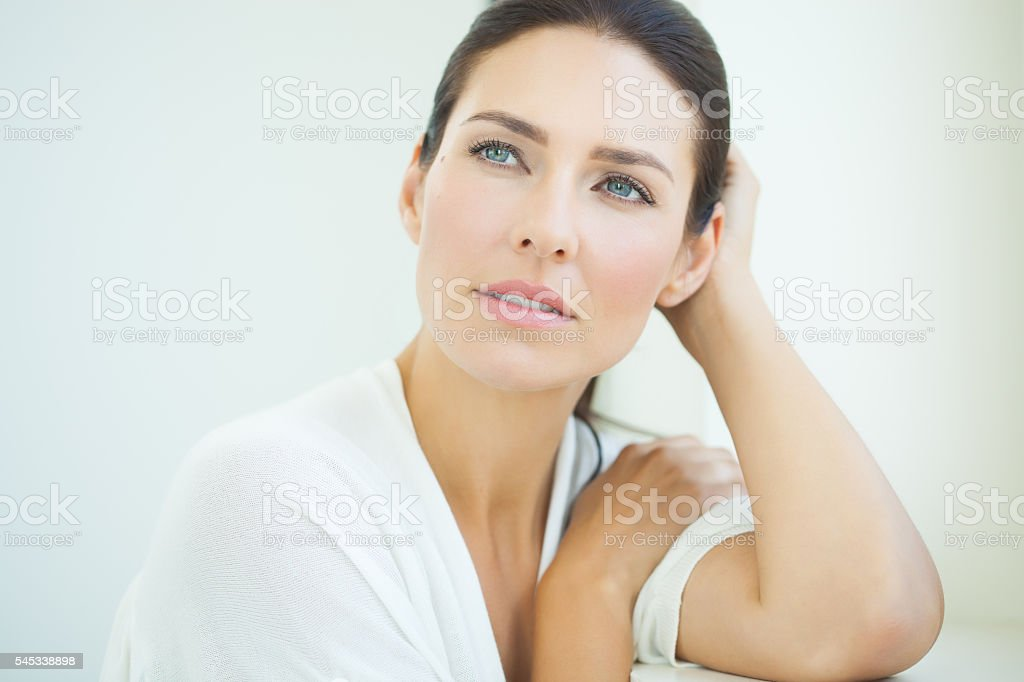 Beautiful Woman At Window royalty-free stock photo