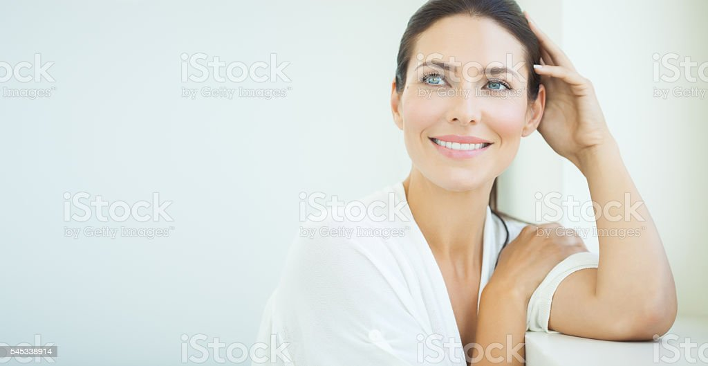 Beautiful Woman At Window stock photo