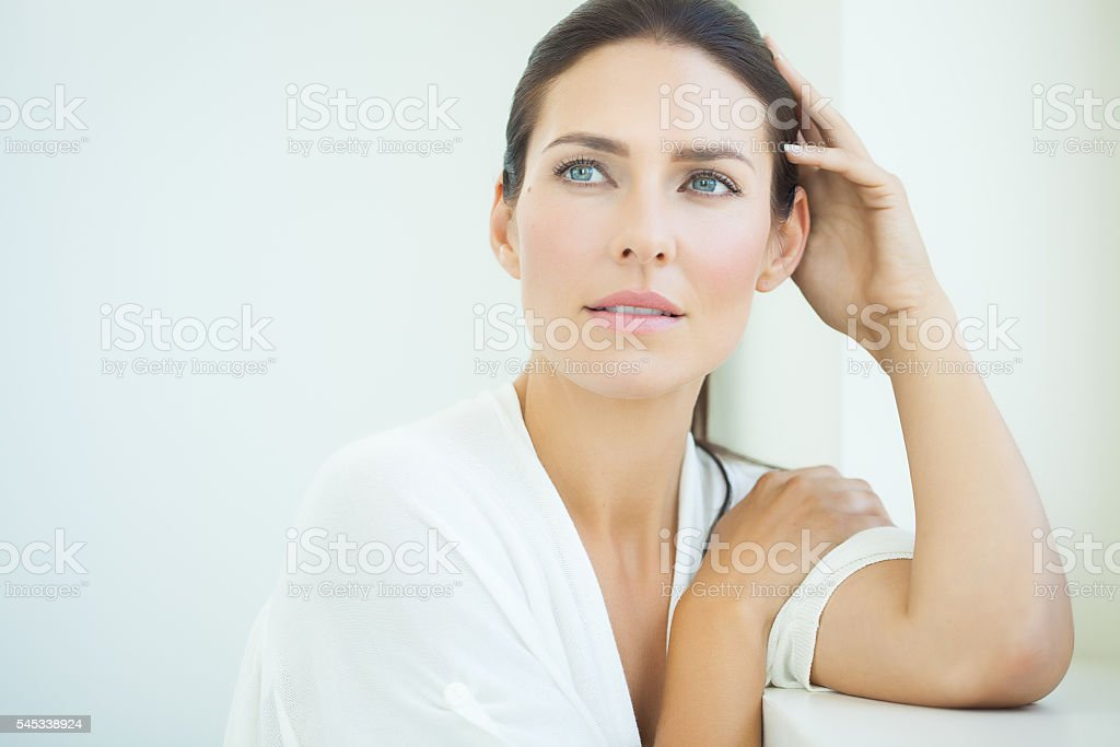Beautiful Woman At Window stock photo