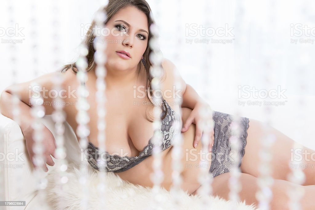 Beautiful woman behind crystal curtain royalty-free stock photo