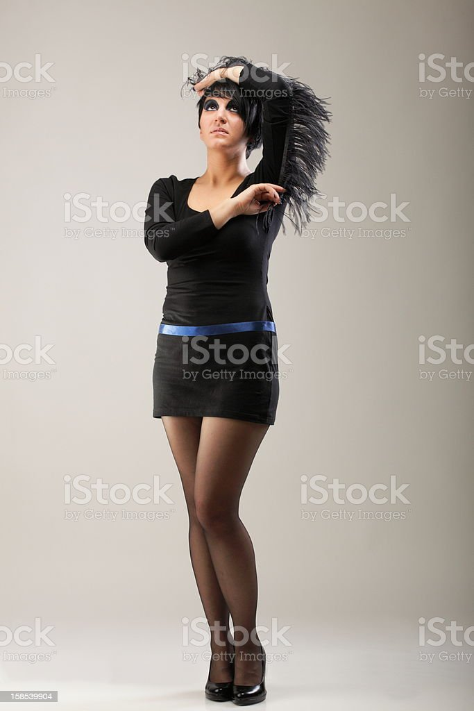 Beautiful woman black dress posing in studio royalty-free stock photo