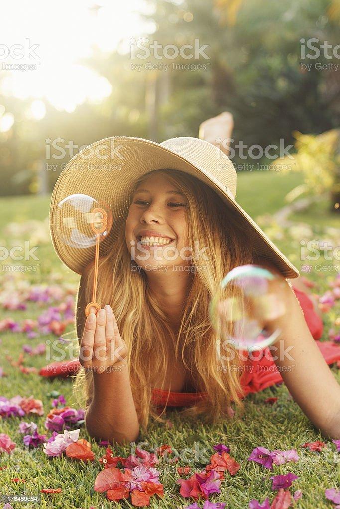 Beautiful Woman Blowing Bubbles royalty-free stock photo