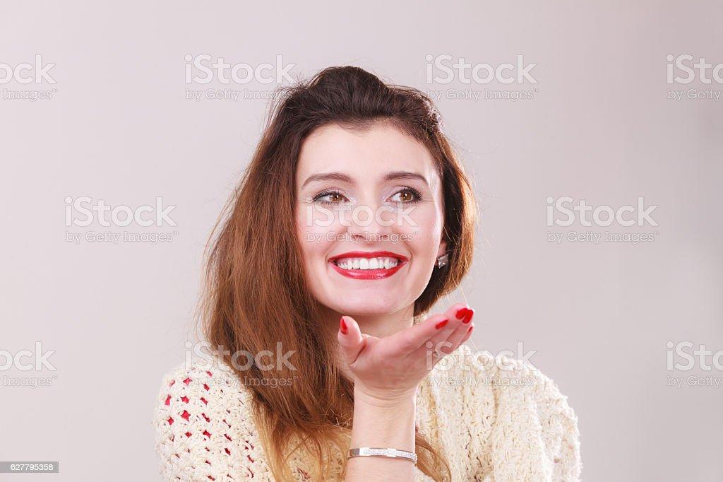 Beautiful woman blowing kiss stock photo