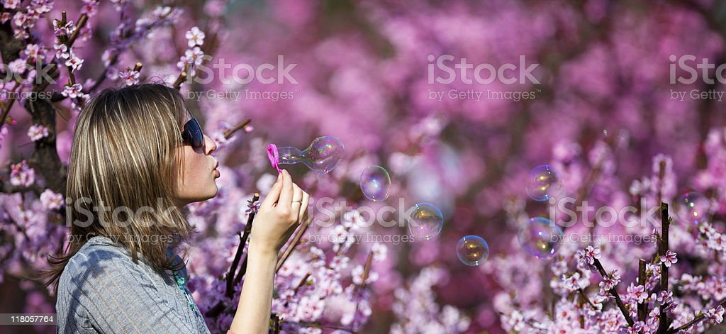 Beautiful  woman blowing soap bubbles royalty-free stock photo