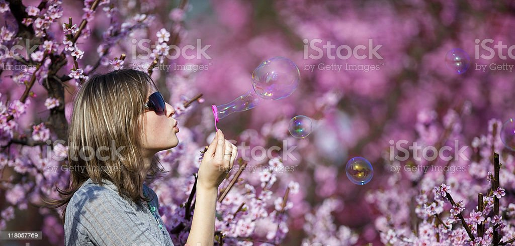 Beautiful  woman blowing soap bubbles royalty-free stock photo