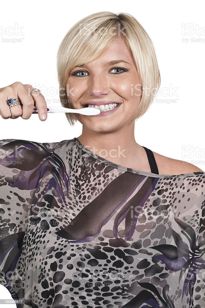 Beautiful Woman Brushing Teeth royalty-free stock photo