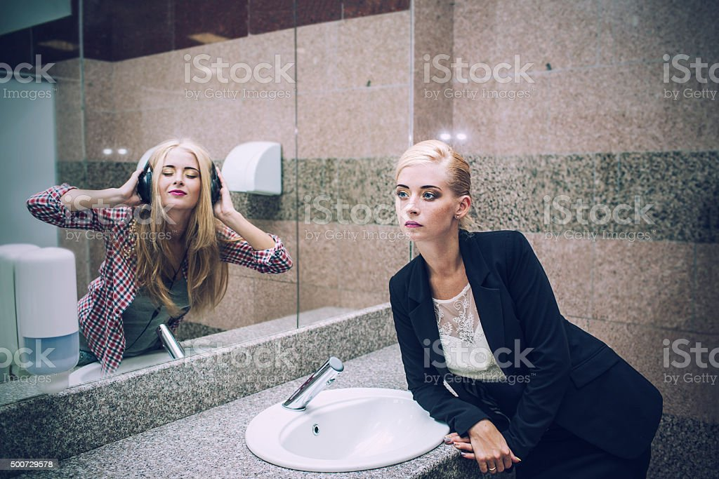 Beautiful woman businesswoman in front of a mirror stock photo