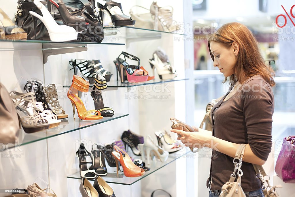 Beautiful woman buys shoes. royalty-free stock photo