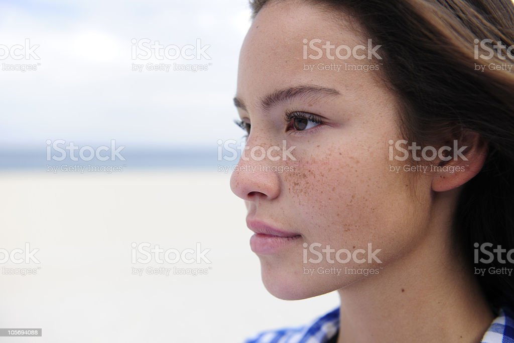 beautiful woman by the beach with copy space stock photo