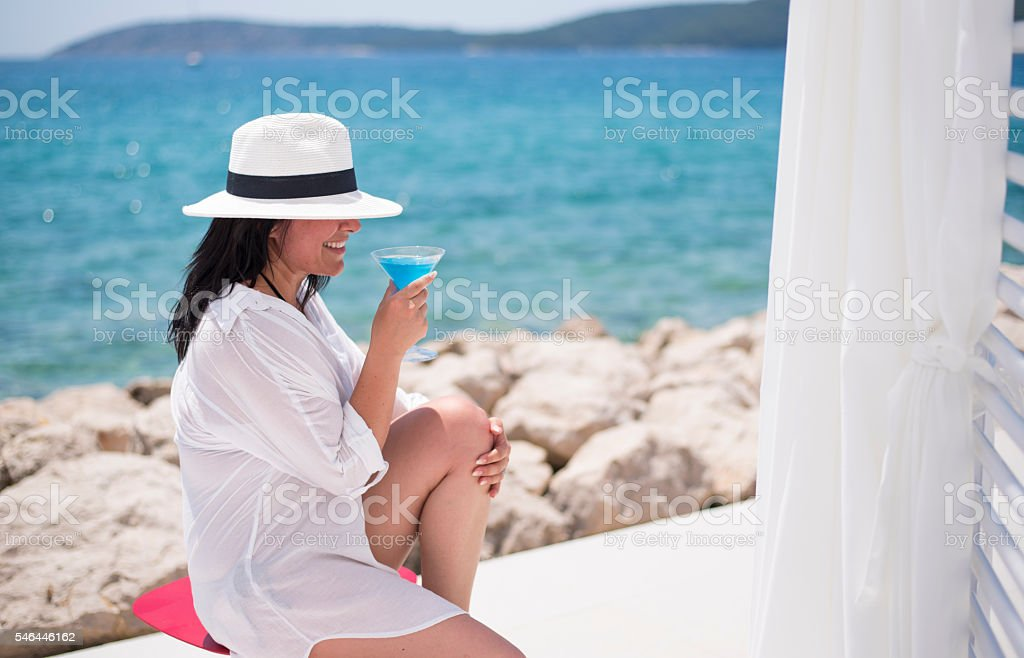 Beautiful woman by the sea stock photo