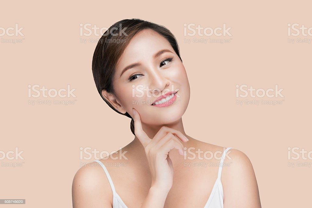 Beautiful woman cares for the skin face stock photo
