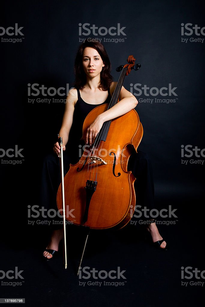 Beautiful woman cellist with her instrument stock photo