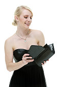 Beautiful woman checking purse