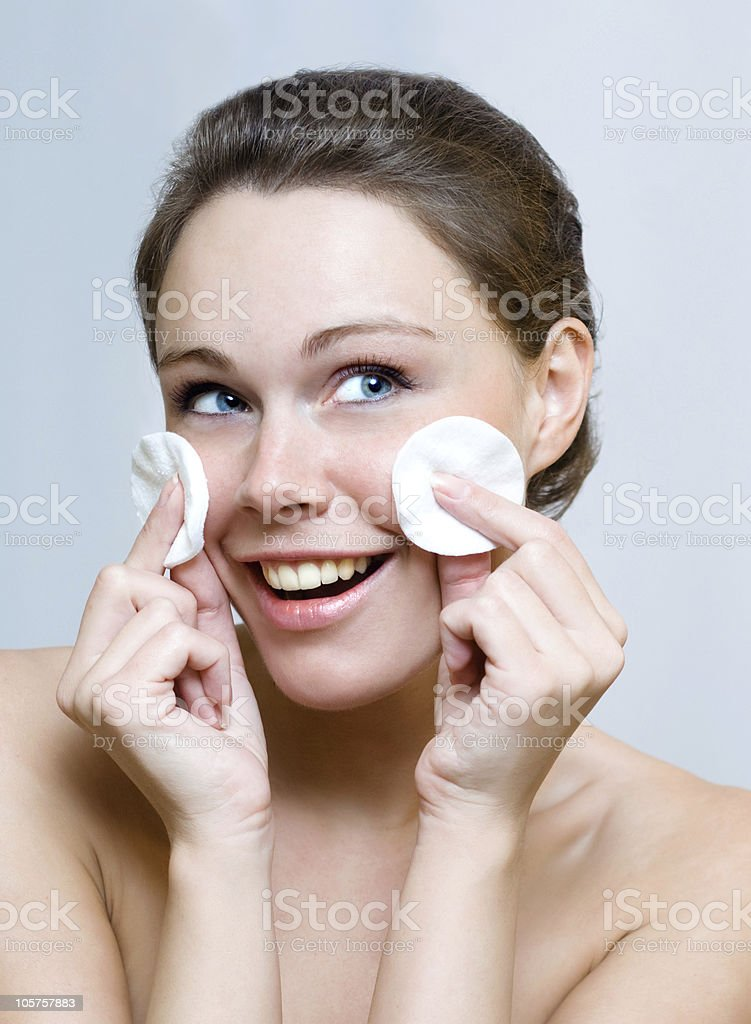 Beautiful woman cleaning face by cotton pad royalty-free stock photo