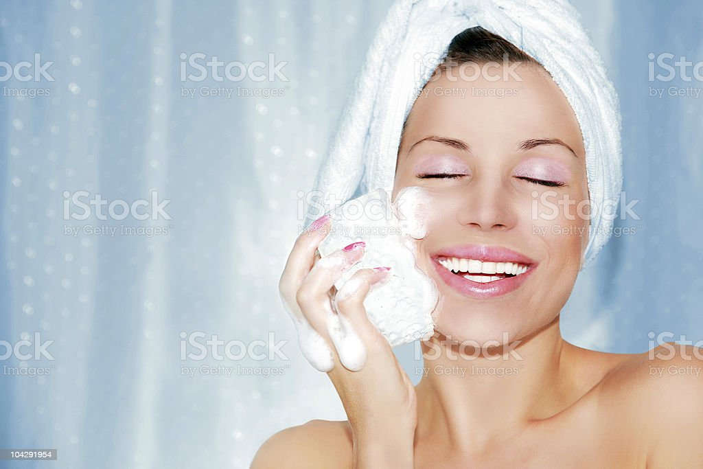 beautiful woman cleaning face royalty-free stock photo