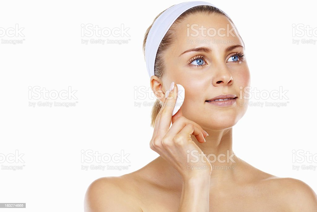 Beautiful woman cleaning her face with cotton swab royalty-free stock photo