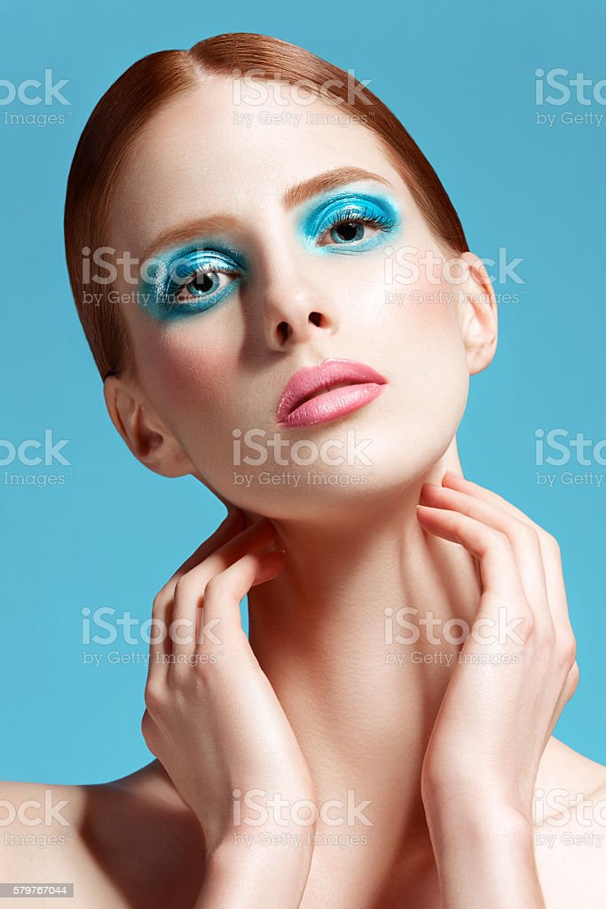 Beautiful woman close up, high-quality beauty on blue background stock photo